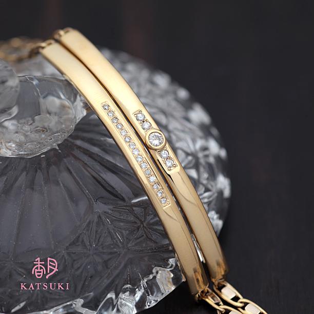 眼鏡の地金と指輪のダイヤモンドで仕上がった豪華なバングル